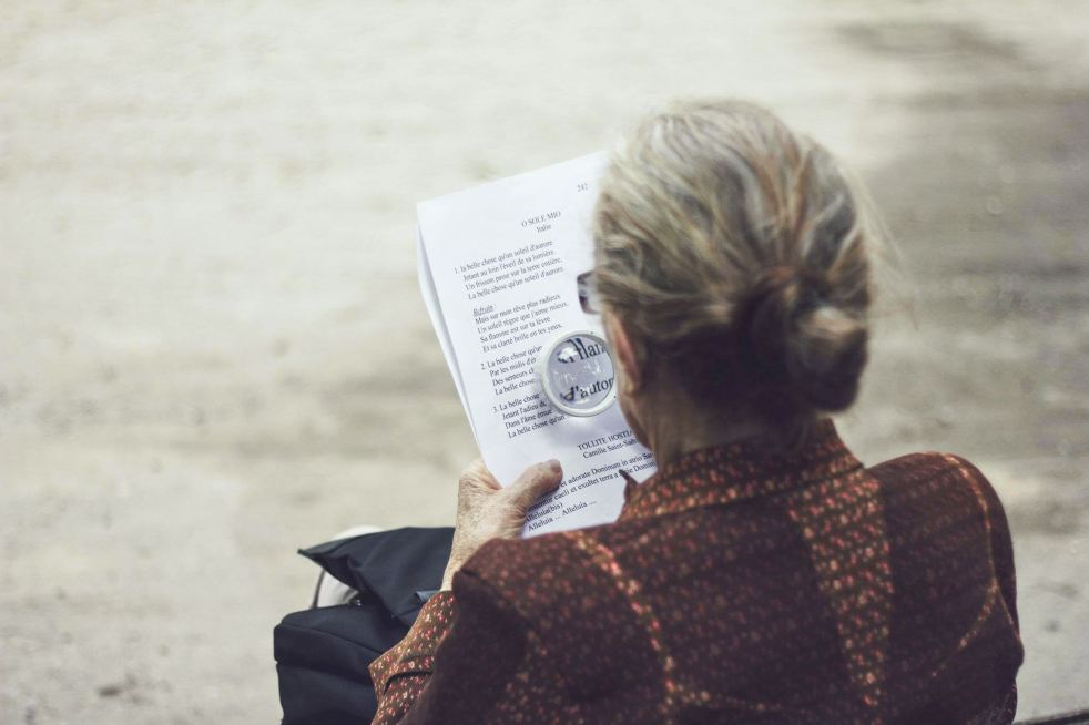 Lady using magnifier to